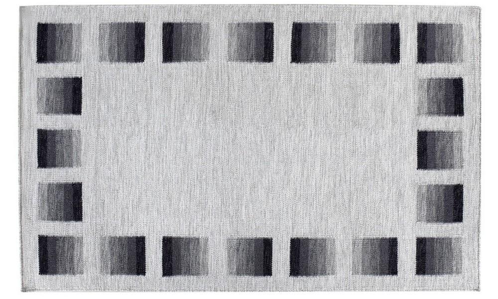 Gent tæppe i grå farve